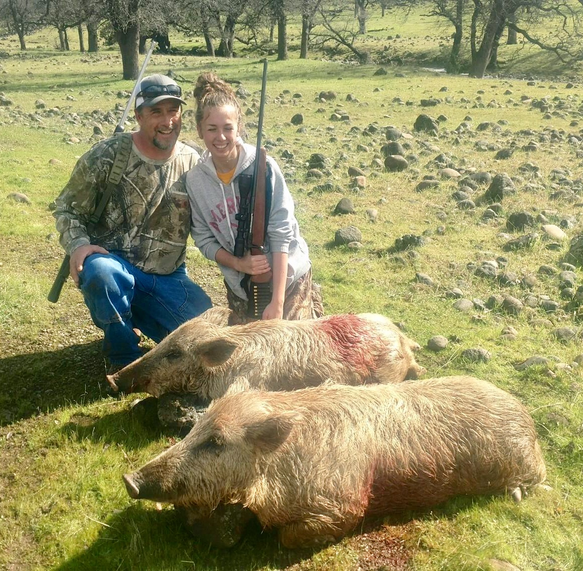 Mike and his daughter with her first pig