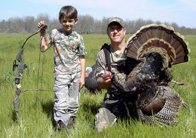 Parker and daddy  Dan with a archery  bird